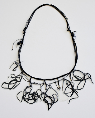 Stripes in the wind, 2012, necklace, laminated paper, recycled plastic, semi precious stones, wax cord, metal alloy,photo by Yannis Mathioudakis