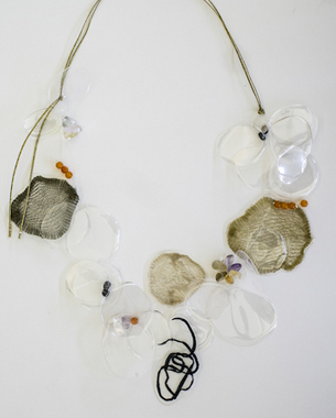 Transparency 1, 2013,necklace, recycled plastic, laminated paper and metal wired surface, semi precious stones, wax cord, photo by Yannis Mathioudakis