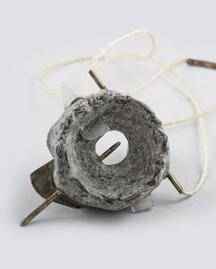 Weapon 03, 2015 Pendant Bronze, concrete, glass, rope Photo: Yannis Mathioudakis
